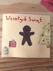 Kartka ze świątecznymi prezentami.